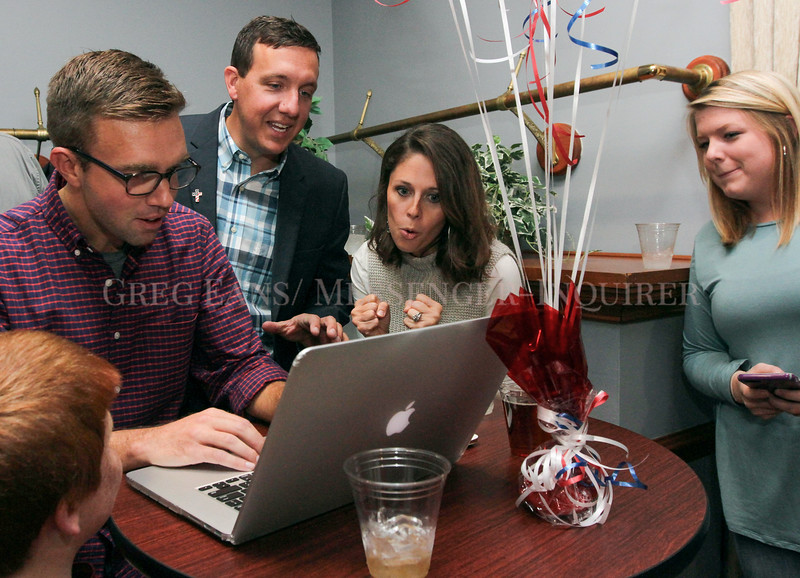 Photo by Greg Eans, Messenger-Inquirer.com/geans@messenger-inquirer.com<br /> <br /> Matt Castlen, second from left, reacts to election results with his wife, Laura, as supporters Jason Tanner, left, and Kaitlyn Austin, right, look on at the Pearl Club in Owensboro.