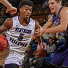 Photo by Greg Eans, Messenger-Inquirer.com/geans@messenger-inquirer.com<br /> <br /> Kentucky Wesleyan's Jordan Jacks drives down the lane against Winona State's Conner Flack during a college basketball game  at the Owensboro Sportscenter in Owensboro, Ky.