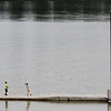 "Photo by Greg Eans, Messenger-Inquirer.com/geans@messenger-inquirer.com<br /> <br /> Willie Barrera, 13, casts a line out into the Ohio River while fishing with his brother, Erik, 18, left, at English Park. The two had just come to town from Florida with other family members to work at harvesting vegetables in Daviess County. ""We're getting some fishing in while we can,"" Erik Barrera said. ""We start tomorrow and won't have a break for about a month."""