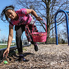 Keiaya Farmer races along the edge of Dugan Best Park, picking up Easter eggs hidden on the playground of the park at the Dugan Best Recreation Center on Friday, April 7, 2017, in Owensboro, Ky. The recreation center was holing its annual Easter egg hunt, hiding 300 plastic filled with candy for children to find. (Greg Eans/The Messenger-Inquirer via AP)
