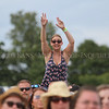 Photo by Greg Eans, Messenger-Inquirer.com/geans@messenger-inquirer.com<br /> <br /> A fan cheers while supported on the shoulders of a friend during the 2016 Big O Fest at Reids Orchard in Owensboro, Ky.