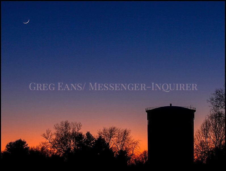 In this Thursday, Jan 18, 2018 photo, a waxing crescent Moon sets at upper left as dusk falls over the Hillcrest Golf Course in Owensboro, Ky. (Greg Eans/The Messenger-Inquirer via AP)