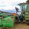 Photo by Greg Eans, Messenger-Inquirer.com/geans@messenger-inquirer.com<br /> <br /> Kyle Kamuf,, top, works with his brother, Ben Kamuf, center, and father Roger Kamuf, right, on a combine on a section of their farmland off of Kentucky 81.