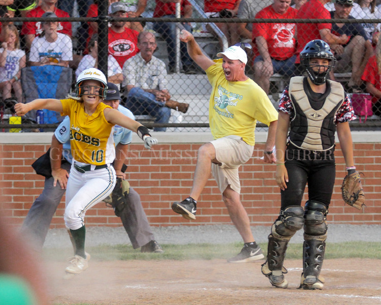 Photo by Greg Eans, Messenger-Inquirer.com/geans@messenger-inquirer.com  <br /> <br /> Owensboro Catholic's Macy Peak (10) scores the winning run as coach George Randoph celebrates  in the background and Daviess County's catcher Mary Thomson waits for the throw in the bottom of the 7th inning during the 3rd Regional Softball Tournament championship game at  Ray Jones Sports Complex in Greenville.