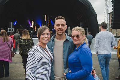 Tara McLaughlin, Chris Darragh and Claire Thompson enjoyed the music.  Photo by Ronan McGrade