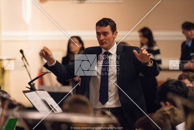 Simon O'Hare conducts the brass band at the St Michael's carol service.  Picture: Ronan McGrade