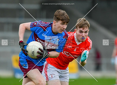 Micheal Glynn makes a break for St Michael's as Luke Gallagher closes in for St Colman's.  Picture: Ronan McGrade