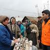 NFI Coordinator Vartan Muradyan with elderly locals