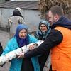 Shelter NFI Officer Stas Dymkovskyy with local elderly women