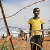 Simon outside his tent/home - on the road to the school