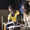 Simon teach his father Daniel the homework