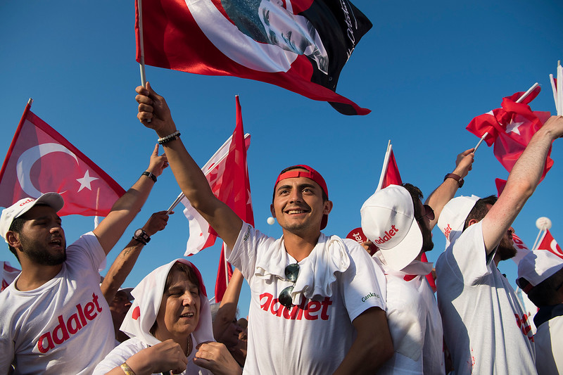 Supporters cheer at a meeting of the Main opposition Republican People's Party (CHP) in Maltepe, Istanbul, Saturday July 9, 2017. The rally marked the end of the adalet or 'justice' march from Ankara to Istanbul, protesting crackdowns of press freedoms.