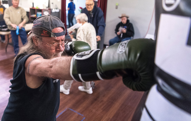 Danny Chaffin hits the punching bag during a demonstration for Rock Steady Boxing, a fitness program designed to lessen the symptoms of Parkinson's Disease at SNAP Fitness in Cedar City Wednesday, April 4, 2018. Rock Steady, SNAP Fitness, and Southern Utah University's Fitness Alliance partnered together to showcase the programs available for those suffering from the disease.