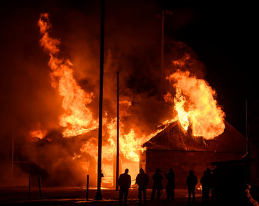 Cedar City Fire Department participates in a controlled burn of the Bicentennial Park building Friday, November 30, 2018. The burn was used as a training exercise for more than 20 fire fighters.