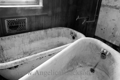"""Rings"" (Black & White) Bathtubs in 3rd floor bathroom, complete with artistic rings and scum deposits. April 2013"