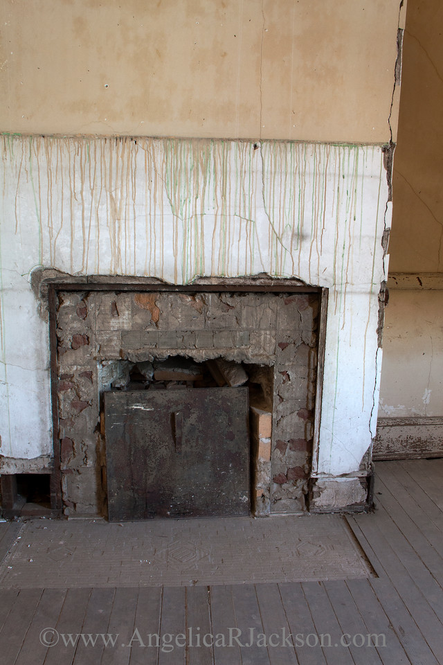 """""""Bricked""""<br /> An example of a fireplace with the mantel removed--probably during the free-for-all after the school closed and the public was invited to take fixtures.<br /> April 2013"""
