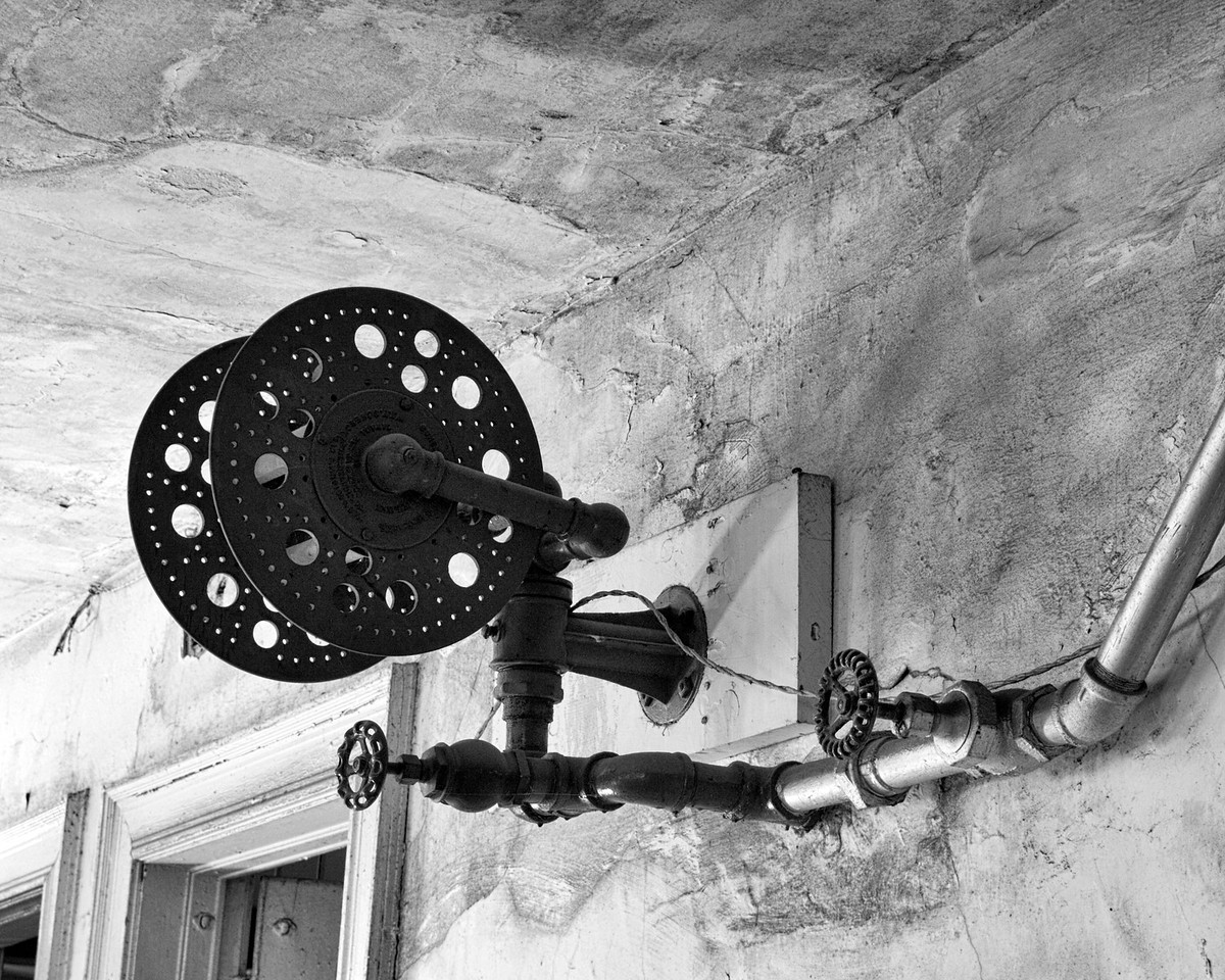 """""""Color Wheel""""                                                                 Hose reels are spaced throughout Preston Castle; this one is in the rough-ceilinged hallway on the lower level."""