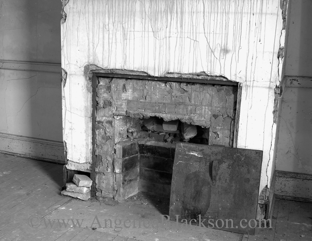 """""""Unrestored Fireplace""""<br /> This is a fireplace in one of the staff living quarters; restoration on the fireplace in the staff dining room has begun."""