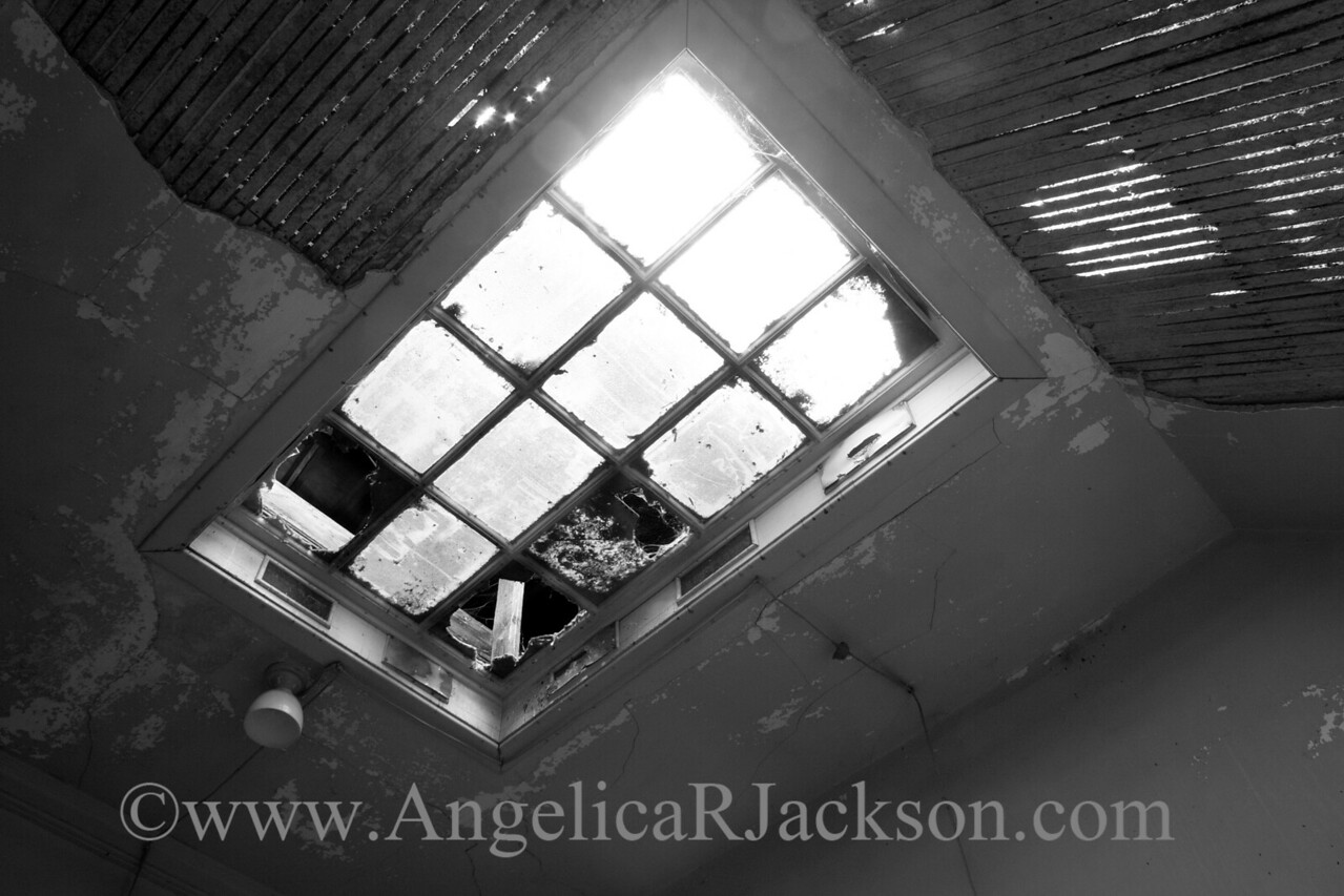 """""""Attic Light"""" (Black & White)<br /> Curiously, this skylight actually leads into the unfinished 4th floor, and there is a corresponding skylight cut into the roof above.<br /> April 2013"""