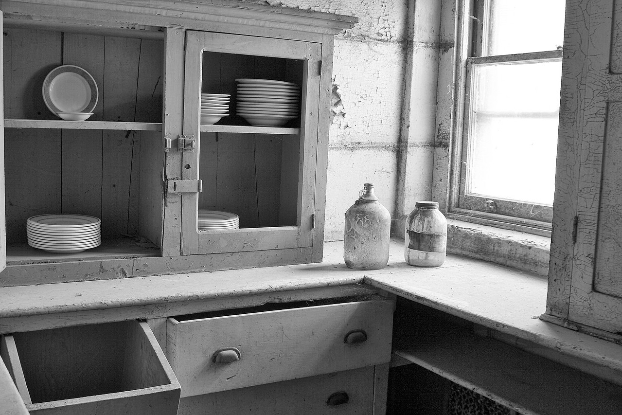 """""""Kitchen Stores 2""""<br /> The dishes in the cabinet are original to the Castle."""