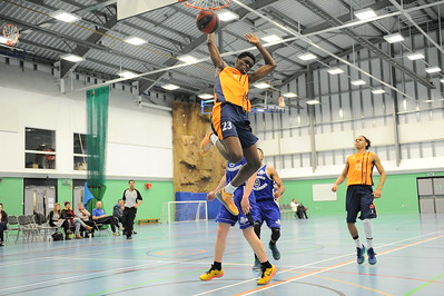 HALIFAX, ENGLAND:  Sheik Sheriff throws down the one-handed slam dunk during his side's away game against Calderdale Explorers at The Inspire Centre, Halifax on 21st December 2015.