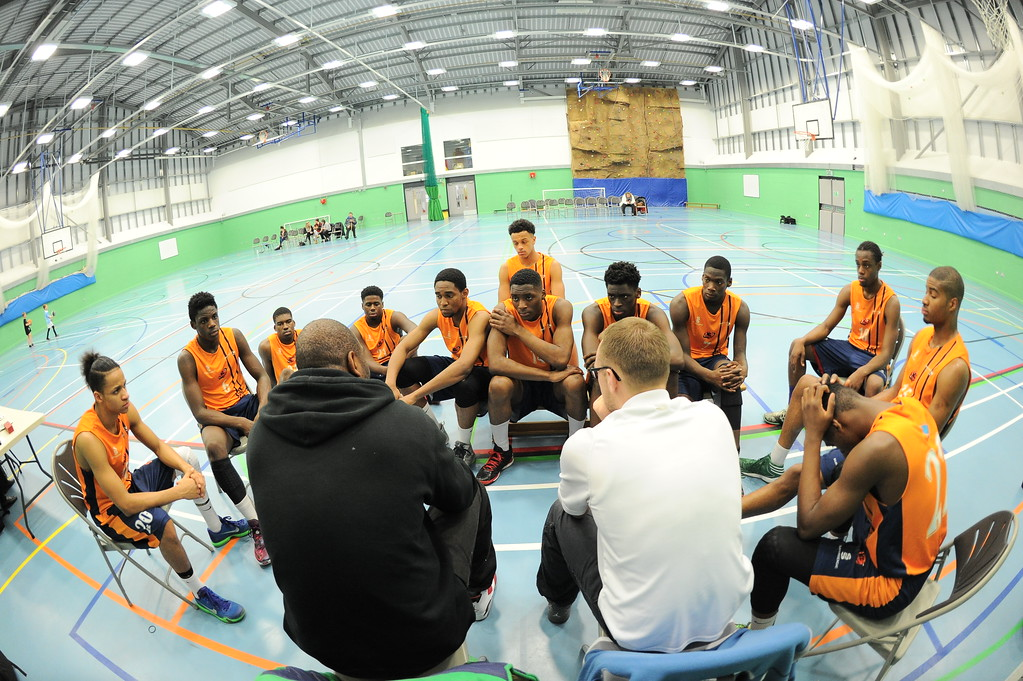 HALIFAX, ENGLAND:  Coaches Corner as the Preston's College players listen intently to Coach Malcolm Leak during his side's away game against Calderdale Explorers at The Inspire Centre, Halifax on 21st December 2015.