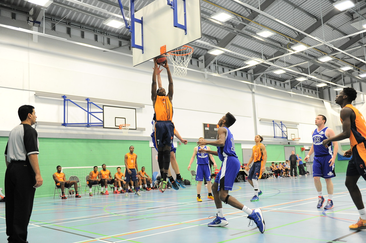 HALIFAX, ENGLAND:  Preston's Melkisedek Moreaux goes up for the slam dunk during his side's away game against Calderdale Explorers at The Inspire Centre, Halifax on 21st December 2015.