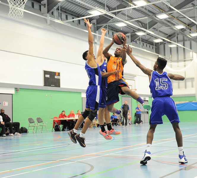 HALIFAX, ENGLAND:  Preston's College captain Javel Small has a trio of defenders on him as he tries to make the basket during his side's away game against Calderdale Explorers at The Inspire Centre, Halifax on 21st December 2015.