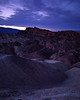 The tilted lakebed deposits of Zabriske Point in the fading light.