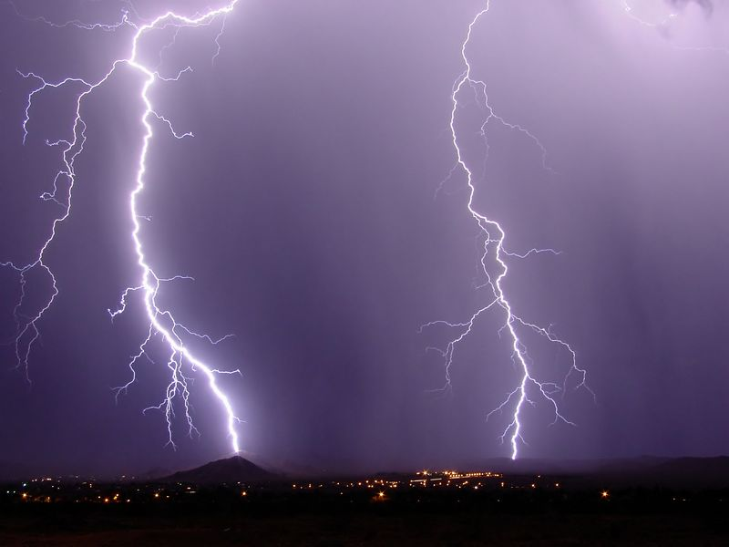 Two bolts of lightning strike south of Ridgecrest, CA.<br /> Photo taken from driveway of rented house.