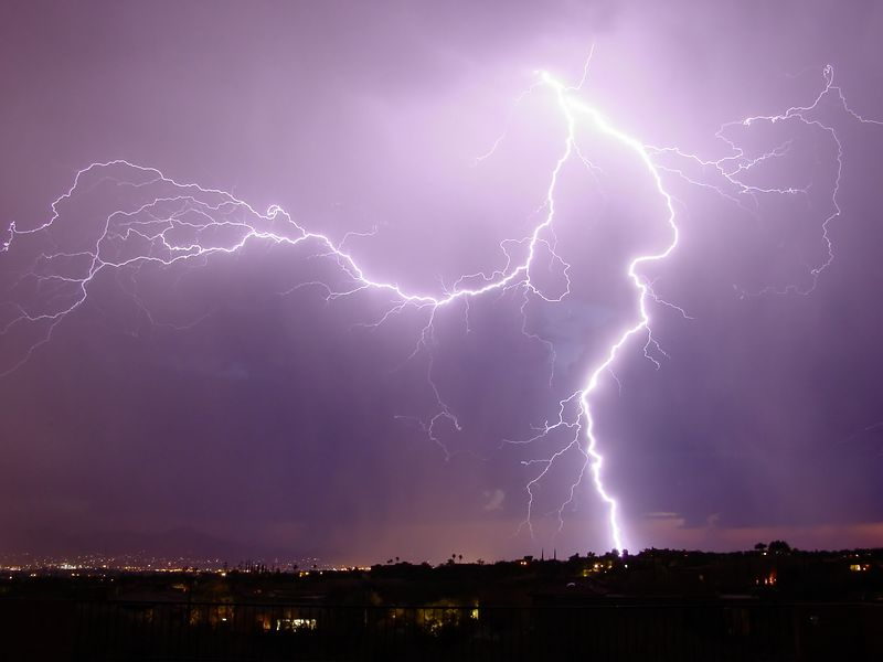 Lightning strikes west of our house in Tucson.  <br /> Photo taken from the back yard.