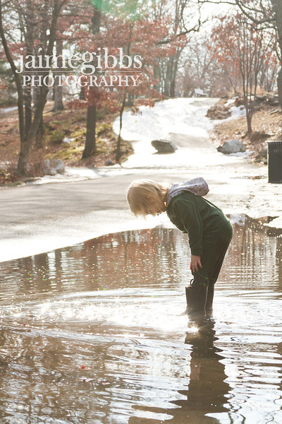 My daughter's first time puddle-jumping with her new rain boots. At first I think she was hesitant because the puddles were really deep but she got into it really quick. I will post more pictures later.