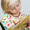 This is exactly how I will always remember Lucy at age 3... caught up in a book. She absolutely loves books. When we read her a book, she listens intently and then replays the story later. If it is a book we have not read her yet, she likes to create her own story from the pictures.