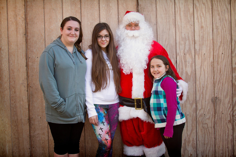 Finishing up Santa pics... they are so much fun!!!!<br /> Posting 2 pics of some lovely girls Santa ran into at the park.