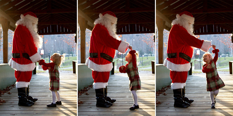 "A preview from Santa in the Park...my little girl. When you look at the photo you can almost hear her say... ""Santa... will you dance with me?"" Such a sweet moment captured. Thankfully, Santa is a good sport."