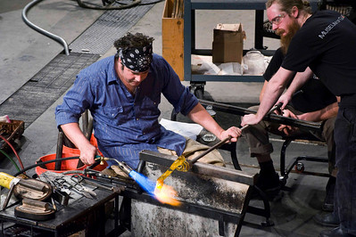 Museum of Glass - workshop; this is part of the Hot Shot crew, who were building a glass piece designed by a child.  The portion you see in this image is part of the snake.  What amazing teamwork to watch!
