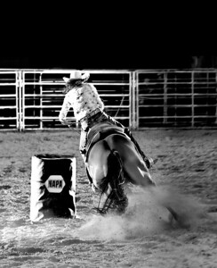 barrel racing in the lights