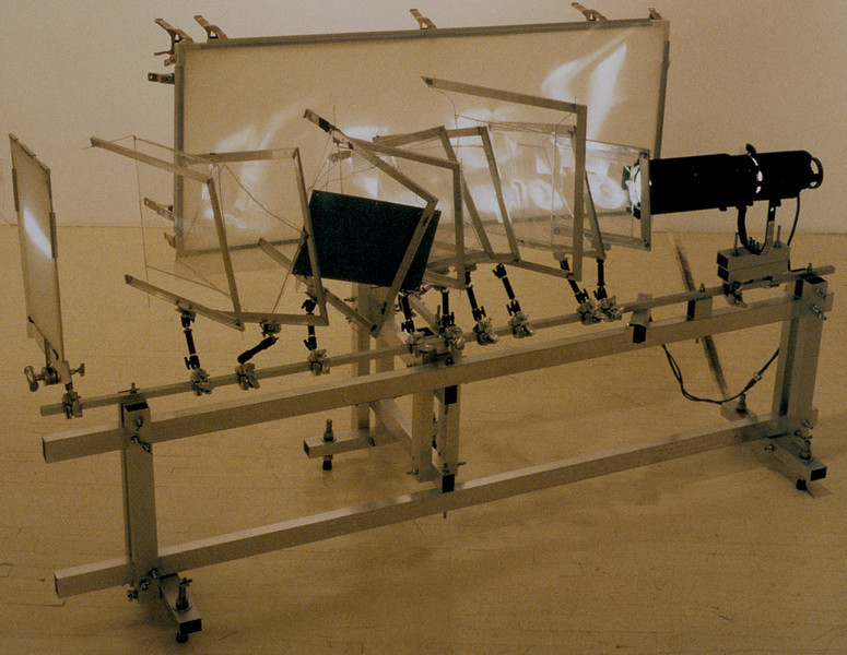 Modern post-Modern signs (back view). Aluminum, Mylar, clamps and light source, 6'h x 5'w x 10'l, 1999.