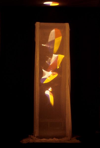 mondrian tower. Projector, silk, aluminum, structure / 8h' x 2w' x2d,' 1996.