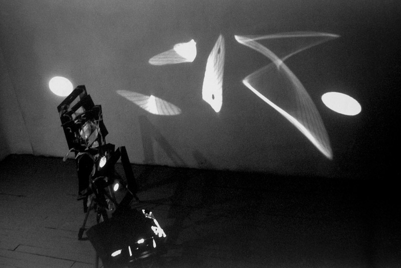 Pleonastic Transmission of Light. Aluminum, Mylar, tripods and light source, 7'h x 4'w x 8'l, 1997.