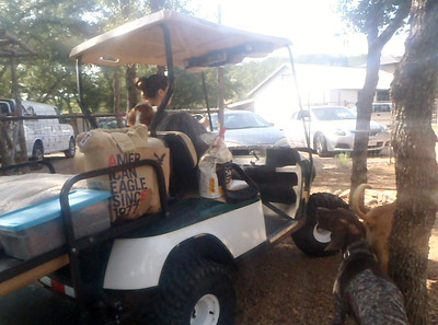 Lena has some help from Brigette with the golf cart