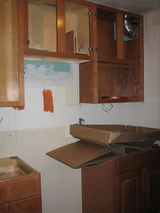 Day 5: More cabinets hoisted (and future location of the stove).  Wasted space taken up by exhaust vent is almost completely recovered in new kitchen.
