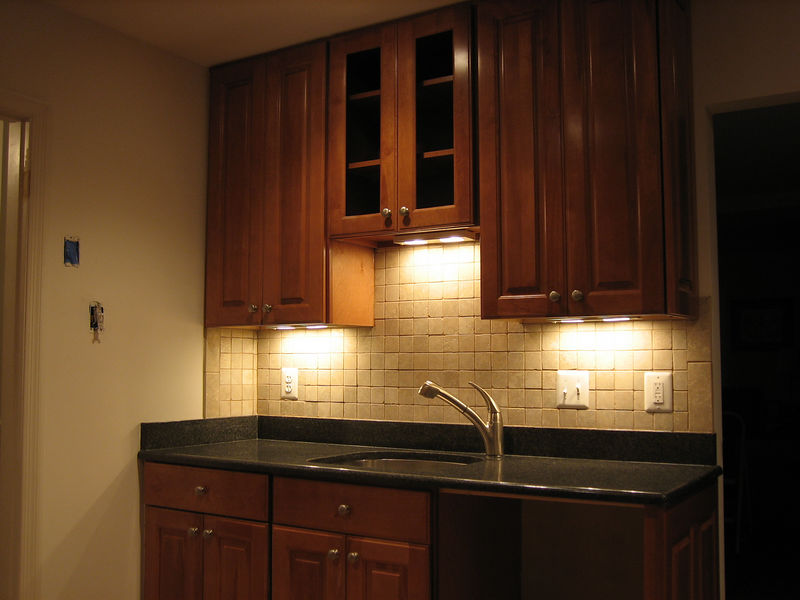 Day 10: The under cabinet lights really set the mood.  We may just eat off the counters from now on.  Still waiting for the new phone jack, dimmer light switch, and dishwasher to be installed.