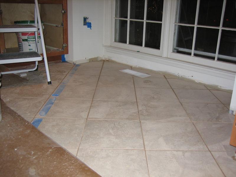Day 9: Tile floor installed