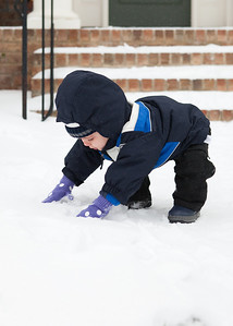 It's in a boy's DNA to create snow balls.