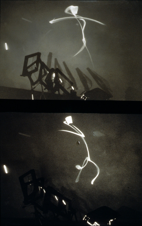 Stick Figures. Aluminum, Mylar, tripods and light source, 7'h x 4'w x 8'l, 1997.