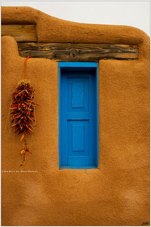 """""""Azul de Taos"""" Located across from the famed San Francisco de Asis Mission Church in Ranchos de Taos, NM, a simple timber and adobe home presents a vivid blue window to the world to welcome friendly spirits or ward off evil ones, depending on who you might ask."""