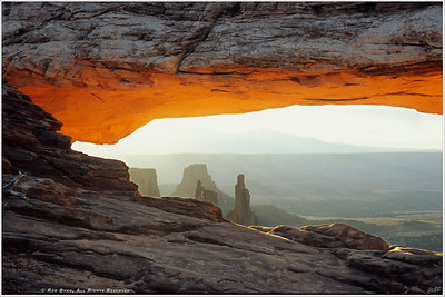 """Beyond"" Sunrise at Mesa Arch. The magical light of each new day reflects the very essence of life and rebirth, provoking discussion of what may lie ""Beyond"" our existence."