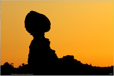 """In Balance"" A spectacular sunset at Balancing Rock in Arches National Park."