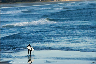 """The Board Meeting"" Surf's up on this weekday morning in Ogunquit, Maine. As day breaks, a handful of adventurers take advantage of an oncoming weather front to catch a few waves before heading in to the office."